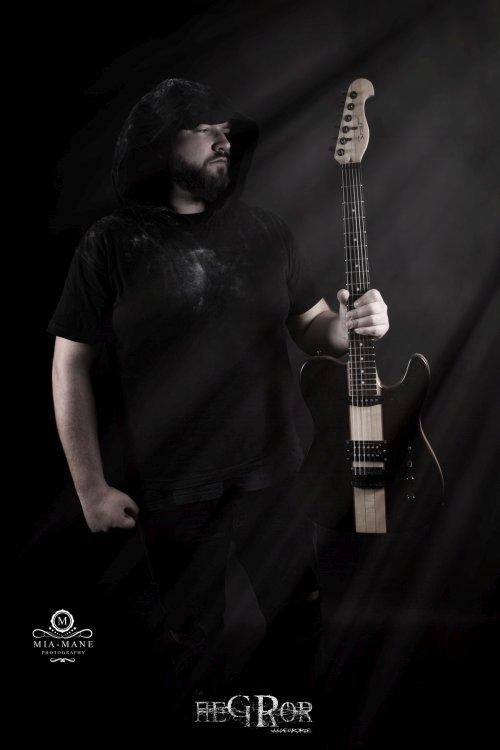 Aegror plays spear guitar